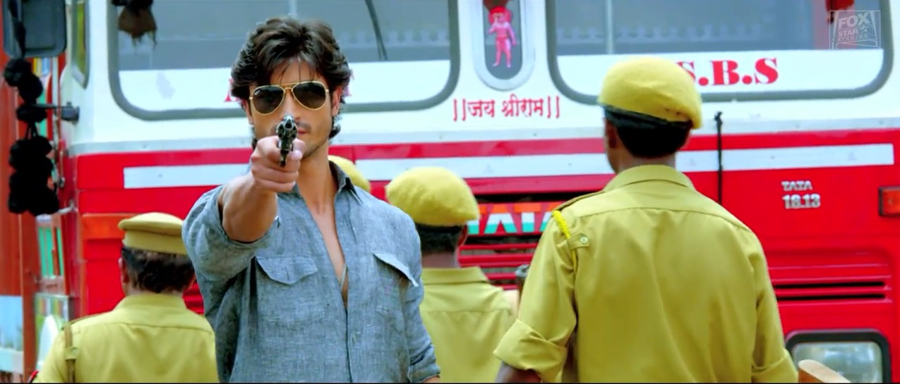 Super Cop Vidyut Jamwal Pointing Gun to Some one On The Trailer of Bullet Raja